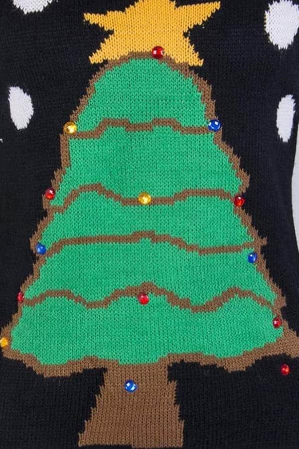 Pull moche femme avec un sapin de Noël et des flocons - détail matière